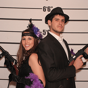 DC Murder Mystery party guests pose for mugshots